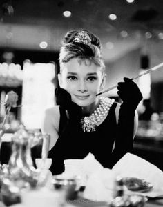Audrey Hepburn - Breakfast at Tiffanys I have this picture hanging up in my room