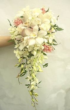 While I don't care for the main part of this bouquet, I do like the bottom portion. It's good to have a lot of options for the bottom (you want something that your florist can get and feels comfortable with) given that it is such an important element and statement for this type of bouquet.