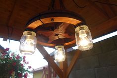 Country style wheel chandelier Wheel Chandelier, Country Style, Light Bulb, Lamps, Lights, Handmade, Home Decor, Bulb Lights, Highlight