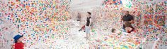 Yayoi Kusama: The Obliteration Room. Project at Queensland Museum that started out with a blank room, everything white. Visitors added the dots.