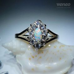 Lostris. Silver or Gold Opal Ring with Zircons all sizes by Veneo, $74.00