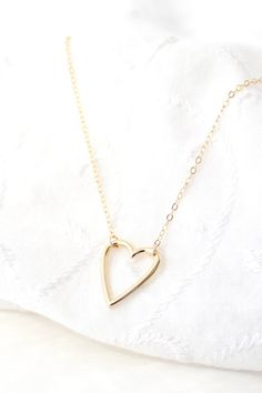 THIS LISTING INCLUDES • A delicate gold heart outline pendant necklace on 14K gold-filled chain • Gift-wrapped with note in box and name tag on outside of box MATERIALS • 14K gold-filled chain and findings (not just plated - perfect for sensitive skin) • gold plated over brass heart