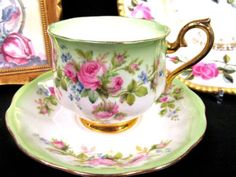 Royal Albert tea cup and saucer lime Green & pink roses pattern teacup pot belly