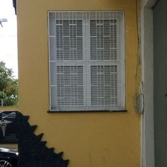 Grills on a window at Fortaleza, Ceará, Brazil.   #window #grills #windowGrill #windowGrills #windowGrate #janela #grades #gradeDeJanela #janelaComGrades #lines #linhas White #branco #yellow #amarelo #windowsanddoorsgrills #fortaleza #ceara #brasil #brazil #colors #noFilter