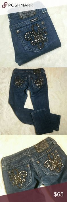 "Miss Me Fleur-de-lis Bling Straight Jeans Size 26 Miss Me Fleur-de-lis Bling Straight Leg Jeans, size 26. Inky dark blue wash. Bling and chain embellished faux leather fleur-de-lis pockets in black and silver. All embellishments intact.  All rivets intact. Button and zip fly. 98% cotton and 2% elastane provides a comfy stretch denim. Preowned in great condition with no rips, holes, tears or stains. Long 33"" original inseam with clean hems.  Waist 14"", stretch up to almost 15"" Rise 7"" Inseam…"