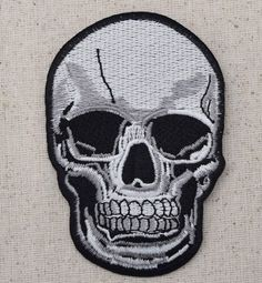 "Human skull Iron on Applique High quality, detailed embroidery applique. Can be sewn or ironed on. Great for hats, bags, clothing, and more! Large Size is approx. 2-1/2"" x 4"" or 5.7cm x 10.16cm"