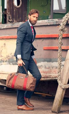 Shop this look for $297:  http://lookastic.com/men/looks/dress-shirt-and-tie-and-blazer-and-dress-pants-and-holdall-and-socks-and-oxford-shoes/1758  — White Dress Shirt  — Red and White Vertical Striped Tie  — Navy Blazer  — Navy Dress Pants  — Brown Canvas Holdall  — Neon Pink Socks  — Walnut Leather Oxford Shoes