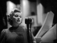 """1938: Appearing on the radio program """"The Phil Baker Show."""""""