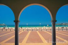 Bondi Beach Pavillion--Looking through the arches of the Bondi Beach Pavilion out to sea, Sydney, New South Wales. Photo by Craig Lamotte
