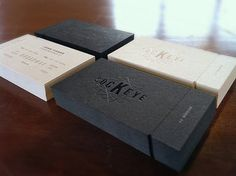 Business cards. Tone on tone ( matte paper + glossy embossed print ) and tear tab contact info. Striking