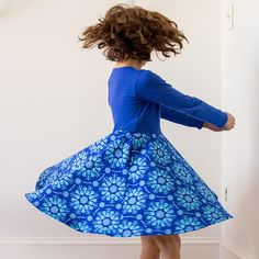 It's a blizzard of beakers! Your little scientist will love twirling around in this swirling snowstorm of pipettes, atoms, and test tubes. With lovely long sleeves and pockets as deep as the cobalt blue fabric, she'll be able to collect specimens wherever she goes.     Sizes 2T, 3T, 4T, 5, 6, 8, 10, 12.