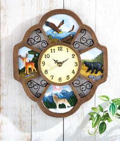 COLLECTIONS ETC.        4-Panel Wildlife Wall Clock