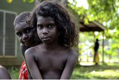 Two children in Ramingining, an Aboriginal village in Arhem Land, Australia. Years after a government intervention, child malnutrition levels remain well below the country's national average. Aboriginal Children, Aboriginal People, We Are The World, People Around The World, Beautiful Children, Beautiful People, Australian Aboriginals, Caucasian People, Photo Images