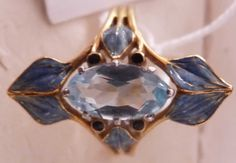 R.Lalique 1910 Oval Aquamar-ine & Leaves Ring: gold w/blue enameled leaves & a central faceted aquamarine stone