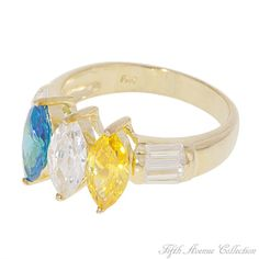 Three For Me! -Deep blue, yellow citrine and sparkling clear marquis cut cubic zirconia, shouldered by the splendor of brilliant baguettes, call to mind a tropical paradise. Set in a swirl of your choice - sterling silver finished in gleaming gold or rich rhodium. Slide it on and feel the magic!