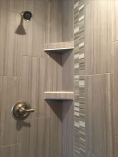 Custom Tiled Shower In A 12x24 Porcelain Tile Install 1/3 Staggered  Vertically With A Stone And Glass Mosaic Accent