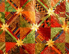 Capadia Designs: Quilt Show Time. Star Blaze quilt. Simple design I can make. Love the colors.
