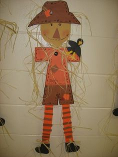 """This scarecrow student project for autumn is so cute.  Adding the """"hay"""" to the scarecrow is the perfect finishing touch!"""