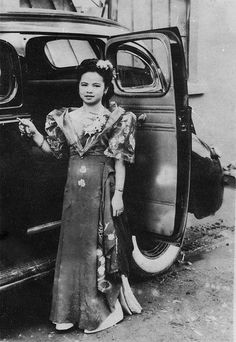 Filipina posing for a photo, c 1940s