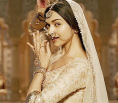 Deepika Padukone plays the role of a Rajput princess in Bajirao Mastani. Note the nath, the maangtika and the lovely delicate hathphool. Indian Celebrities, Bollywood Celebrities, Bollywood Fashion, Bollywood Actress, Indian Bollywood, Bollywood News, Indian Dresses, Indian Outfits, Indian Clothes