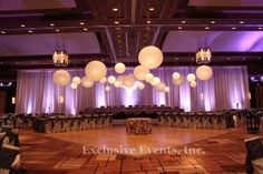 Large paper ball lanterns over the dance floor by Exclusive Events, Inc.