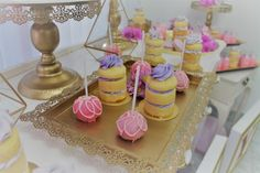 Mini naked cakes and cake pops from a Baby Shower dessert buffet. Pink and purple theme.