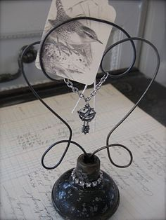 This idea for repurposing vintage doorknobs comes from Petite Michelle Louise.  Isn't it amazing how some bent wire and heirloom jewelry turn worn out knobs into beautiful decor pieces?