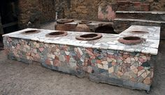 Herculaneum - Grande Taberna. This Taberna has a counter inside and was supposedly a Roman fast-food outlet. Turner, Paul. Herculaneum - Grande Taberna. 12 Sept. 2008. Flickr. Yahoo! Web. 26 Sept. 2011.
