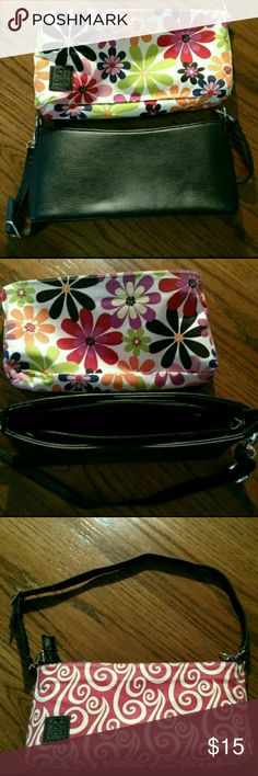 Luvali 3 in 1 purse Luvali 3 in 1 purse.  See images.  Reversible cloth cover with 2 FUN designs or use without the cover for a black leather purse! Excellent, like new condition.  No evident wear, great steal!! Adjustable strap and large interior zipper pouch. Luvali Bags Shoulder Bags