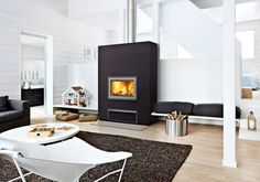 VALKIA NAMMI: The Valkia is a stylish hybrid (wood and pellet) fireplace that brings together efficient heating technology and interior design adaptability.