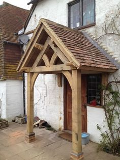 Barn conversions, oak frame garages, porches, kennels, furniture Porch Awning, Porch Canopy, Porch Roof, Door Canopy, Beam Structure, House Entrance, Entrance Ways, Copper Roof, Timber Door