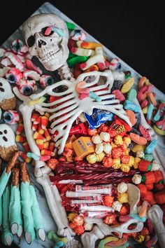 Skeleton party platter Mix fun and fright on your Halloween table by serving up spooky treats inside a candy charcuterie themed skeleton prop.