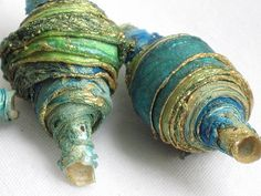 Fabric beads. gold on the ends.