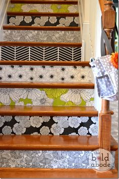 Give a boring Staircase a Facelift with Wallpapered Stairs (maybe stick to one or two patterns!)