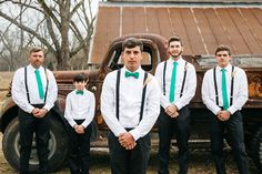 The groomsmen striking a pose in front of our antique pickup truck at Hadley and Kodi's Vintage Rustic Georgia Wedding at Fritz Farm. Photo: TR Photography.