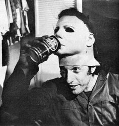 """Nick Castle in his role as Michael Myers takes a break during the filming of John Carpenter's """"Halloween"""". Click the pic for the original theatrical trailer."""