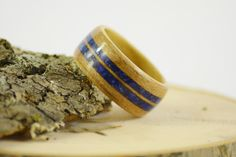 Bentwood cherry ring with double blue lapis inlay on Etsy, $160.00
