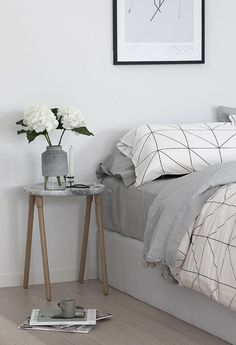 Geometric prints, simple bedside table, white plant, grey and white colours, simple style #geometric #greyandwhite