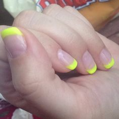 Neon yellow shellac French tips rock.
