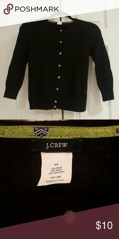 J.Crew Black Wool Cardigan 3/4 sleeve crew neck. Cable knit with crown buttons. 55% wool, 30% nylon, 15% cashmere. XS but fits like XXS. Some pilling and feathers/fuzz from wearing under a down jacket. J. Crew Sweaters Cardigans
