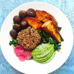 massaged kale and arugula w/ tahini & lemon + roasted shrooms + chipotle roasted sweet potato + lentil burger + pickled radish + avocado + hemp hearts