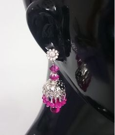 Silver color Base Pink Ear Ring List price: Rs499   Rs199 You save: Rs300 (60%)