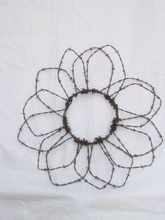 barbed wire flower...CUTE! by diane.smith