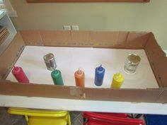 The next painting activity was a little more challenging but very fun. To prepare for this activity, we set out a box with two unopened tin cans (I pulled them from the back of my pantry and only took the wrapper off) and our squeeze bottles filled with tempera paint…The children worked with a partner and began by squeezing paint into the box and on top of the paper…Then the children stood at each end of the box and tipped the box back and forth to roll the cans across the paper