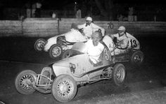 midget auto action from the 50's w/ Sir Jack Brabham at the old Parramatta Speedway in #30, Tommy Bradshaw #13 and Norm Jackson #2 runs up high on the outside...