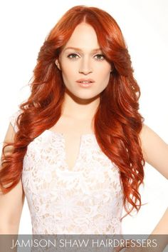 This flaming red style charmingly enhances long, luscious waves with silky texture for a style that commands our attention.