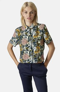 Free shipping and returns on Topshop Floral Print Shirt at Nordstrom.com. A dainty spread collar tops a cropped short-sleeve shirt printed with colorful hand-drawn flowers.