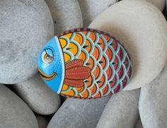 Painted stone colorful fish   Is Painted by Lefteris Kanetis https://www.facebook.com/L.kanetis.paintedstones