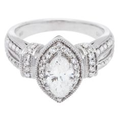 Available as part of the Jewelry Liquidation Vault, this charming women's engagement ring is made of 14-karat white gold and features a total diamond weight of 1.50 carats for a beautiful shine.