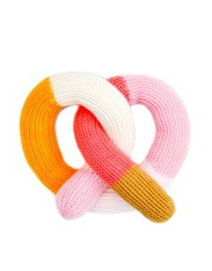 In soft, hand knit cotton, these colorful rattles are a design lover's dream for the stylized nursery. - Cotton - wide - Hand knit in Peru Baby Shower Registry, Baby Shower Wishes, Modern Boho, Baby Toys, Home Goods, Decorative Pillows, New Homes, Knitting, Pretzel